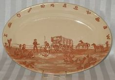 "This restaurant ware platter is by Wallace China of Los Angeles, CA. It is in the hard to find pattern of Chuckwagon and was made for El Paso Hotel Supply Co. of El Paso, Texas. The platter is 13 5/8""."