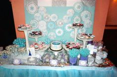 Frozen themed dessert table in blue, white and lavender showcasing several amazing Etsy artisans who added unique details to each dessert