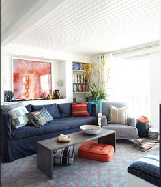 the proportions of cold and warm in this room are well done, by having the cool take the bulk, with orange accents