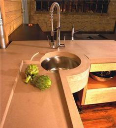 Concrete counter tops.  I love the circle sink!  We were thinking about one of those in the corner.