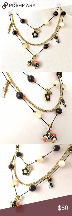 """Betsey J '60s Mod' Scooter Illusion Necklace  NWT From unique, retired collection. Very HTF, NWT. Features one of the collection's scooters and two of the Girl Power 60s fashion figures. Love the milky translucent and black beads. Scooter has  crystals on its headlight, tail light, and seat. Other cute details!  16"""", 18"""", 20"""" chains with extender. Comes with store tag, new condition. Collectible! Betsey Johnson Jewelry Necklaces"""