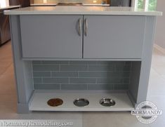 If you want to find a permanent place in the kitchen where your pet cat can eat, consider incorporating a feeding station at the end of the island. You can also add cabinet storage for cat food making daily dispensing easy.
