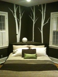 As someone who hates just lining walls with furniture, I love this idea.  Cozy, change the lines of the room, and efficient use of what would other