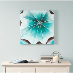 Cool Gem will bring style and a pop of color with this fun and vibrant abstract piece. The geometric shapes are filled with different shades of teal and grey that will brighten up your bedroom wall.