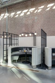 Framework Studio, designed the interior of Meat West, a restaurant located inside De Hallen, a former tram repair depot in Amsterdam. from contemporist Deco Restaurant, Restaurant Interior Design, Commercial Interior Design, Cafe Interior, Commercial Interiors, Luxury Restaurant, Industrial Restaurant, Bar Paris, Design Comercial