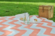 Chevron picnic blanket - on a painters tarp-- cuuuuuuute. Love the coral color