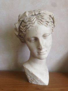This piece is a beautiful museum replica, depicting the head of Thalia, one of the nine famous muses and one of the Three Graces in Greek mythology. This lovely statue is made of white bonded marble and will add that special touch to any décor.  In Greek Mythology, there are the nine