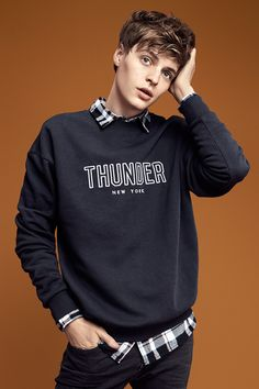 Bring the thunder in this dark blue graphic sweatshirt. Pair with a black & white checked flannel shirt for an unexpected look.   H&M Divided Guys
