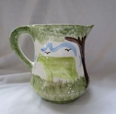 Antique 1945 Cash Family Pottery Multicolored Cow Pitcher
