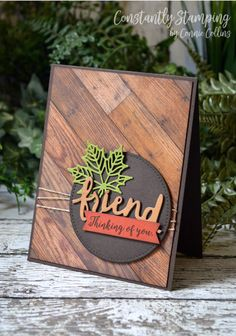 handmade greeting card ... masculine look with photo realistic wood background and black mat ... die cut FRIEND and skeleton maple leaf ... created by Connie Collins ...great card!