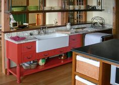 Deep skirt kitchen sink + marble countertop + coral console = brilliant kitchen!