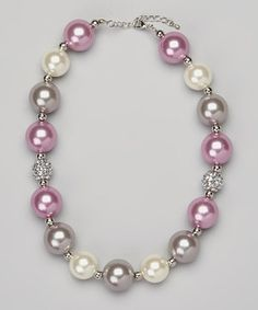 Smooth beads mingle with studded accents on this darling necklace for a sweet, textured look. An adjustable design allows it to fit pretty princesses just right.