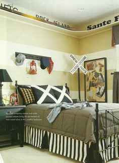 Love the upper shelf for train track and the pillows for railroad crossing...and the train lines painted on the wall too!
