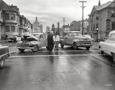 """Oakland, California, c 1956. """"Ambulance at collision."""" The age-old rivalry of Ford vs. Chevy. http://www.shorpy.com/node/19997?utm_content=buffercc965&utm_medium=social&utm_source=pinterest.com&utm_campaign=buffer"""