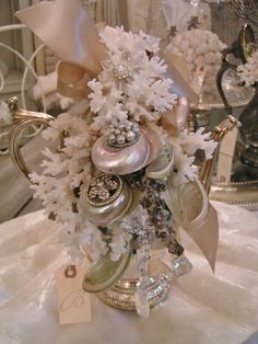 Gorgeous vintage teapot decorated with ocean treasures and a touch of bling...so beautiful!