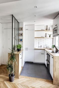 Kitchen with wood flooring. http://www.kenisahome.com