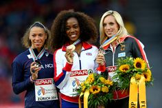 Tiffany Porter (L-R) Silver medalist Cindy Billaud of France, gold medalist Tiffany Porter of Great Britain and Northern Ireland and bronze medalist Cindy Roleder of Germany stand on the podium during the medal ceremony for the Women's 100 metres Hurdles final during day three of the 22nd European Athletics Championships at Stadium Letzigrund on August 14, 2014 in Zurich, Switzerland.