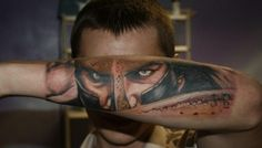 See more Realistic 3D face tattoos on arm... that is so cool!