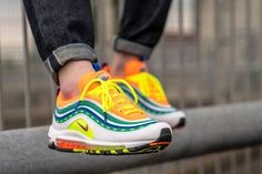 The Air Max 97 London Summer Of Love is painted in a multitude of vibrant hues, including orange, green, yellow, and blue. Air Max 97, Nike Air Max, Air Max Sneakers, Sneakers Nike, London Summer, Summer Of Love, Me Too Shoes, Light Blue, Stuff To Buy