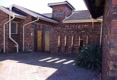 This property comes with pre-paid electricity. A kitchen with wooden built in cupboards, stove with extractor fan and scullery with a double sink. 3 Roomy tiled bedrooms with built in cupboards, 1 with a ceiling fan for those humid nights and 1 with walk in closet. Very neat en-suite bathroom with basin, bath, toilet and shower. 2nd Bathroom has a basin, bath and toilet. Spacious, tiled open plan dining and TV room. Long corridor. Double garage with roll up doors with 3 vehicle parking's and… Roll Up Doors, Court Yard, Built In Cupboards, Extractor Fans, Built In Bar, Pre Paid, Entertainment Area, Double Garage, Real Estate Agency