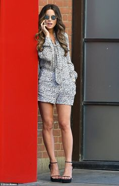 Chic: The 42-year-old actress looked summer-ready in a long-sleeved monochrome playsuit, s...