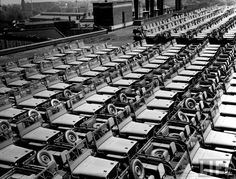 """""""Rows of finished jeeps churned out in mass production for war effort as WWII allies plan for inevitable invasion of Nazi-occupied Europe."""", by Dmitri Kessel, 1942"""