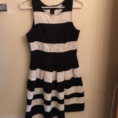Black and white striped dress Black and white lace Francesca's dress. Fitted top, a line bottom. Thick lace material is very flattering. Only worn once, is like new. Francesca's Collections Dresses Midi