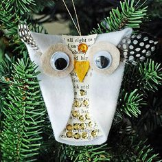 Snowy Owl Ornament. Make this white owl ornament with some felt, googley eyes, and fun feathers sticking out as ears. Add a cutout from an old paperback book to the belly of your wise owl and finish off with some rhinestone bling.