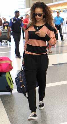 Rihanna: Military Training to Prep for 'Battleship!': Photo Rihanna checks her phone while walking through LAX Airport on Saturday (August in Los Angeles. Rihanna Swag, Rihanna Style, Military Training, Old Singers, Battleship, Her Style, Style Icons, Fashion Forward, Sporty