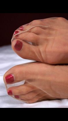 Gorgeous toes in ultra sheer nylons. So hot!