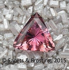 Tourmaline (pink), 5.44 cts, 9mm triangle.  I love this one because when tilted in the light, it sparkles well, but also has flashes of orange in it, too.  <AVAILABLE> on website