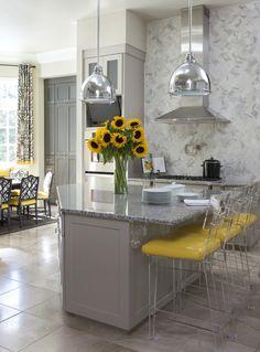 Modern & fresh gray and yellow palette | marble subway tile in herringbone pattern| designer Tobi Fairley