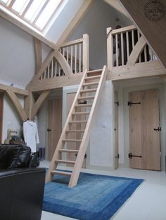 Oak ladder to mezzanine - photo by Carpenter Oak Ltd. Quirky
