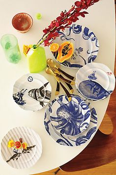 Tentacles off the Table!  Thinking about my New Years setting these are so fun mixed with the bright plates too! From The Deep Side Plate, Octopus - anthropologie.com  $14