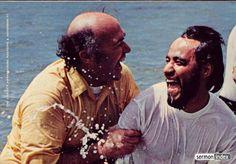 Chuck Smith Baptizing a man in the ocean.