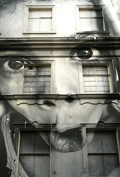 JR the street artist from the UK. Pulls off some cool stuff.