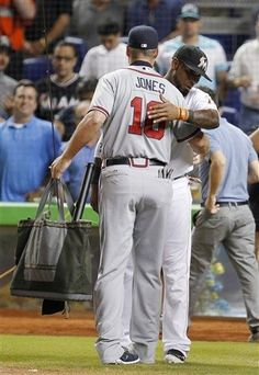 Marlins shortstop Jose Reyes presents Chipper with a fly fishing rod before the game on Sept. 19.  It's great to see how much the other teams really respect him.