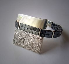 Ring | Milton Lorena. Sterling reticulated silver and black hematite cubes