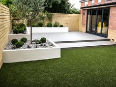 Rendered flower beds, eco decking and artificial lawn | J B Landscapes LTD