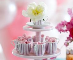 A teacup and saucer filled with one beautiful fresh bloom completes the top tier for a supersweet setting.