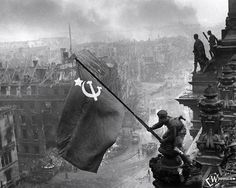 It is a historic World War II photograph taken during the Battle of Berlin by Red Army photographer Yevgeny Khaldei. It depicts several Soviet troops raising the flag of the Soviet Union atop the German Reichstag building. The photograph was instantly popular, being reprinted in thousands of publications. It came to be regarded around the world as one of the most significant and recognizable images of the WW2.