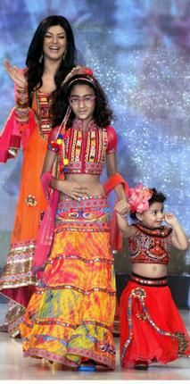 Catching them youngGucci's kids collection; Left, Bollywood actor Sushmita Sen walks the ramp with her daughters during the India Kids Fashion Week