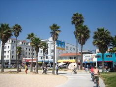 """VENICE BEACH - A popular hangout for the creative and the artistic, Venice Beach is a beachfront district well-known for its canals, beaches, various handball and volleyball courts, and its two-and-a-half-mile pedestrian-only """"boardwalk"""" that features performers, fortune-tellers, artists, and various merchants and dining establishments.) (Photo Credit: Wikimedia Commons User SameerKhan)"""