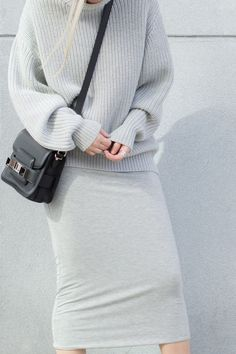 Monochrome look with standout crossbody bag by Proenza Schouler.