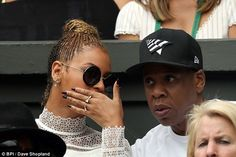 Manicured: Queen Bey covered her mouth as she whispered something to her other half...