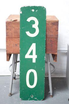 Large green metal number sign.