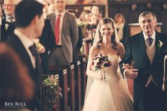We love the slight smile on this father of the bride's face as he accompanies his daughter down the aisle – you can feel the pride radiating from him.