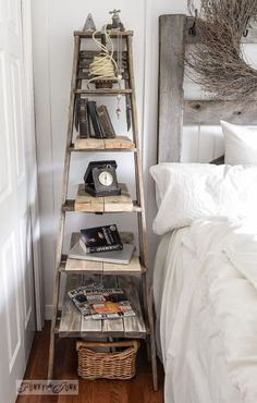 And an old ladder with planks attached created a nice, tall side table perfect for today's very tall beds. A Restoration Hardware look for free! ...from Funky Junk