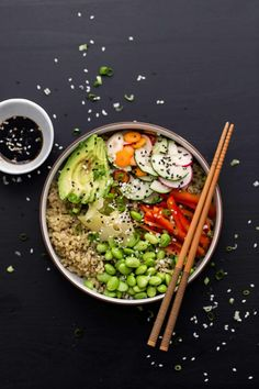 An easy and flavorful vegetarian sushi bowl that features green tea sushi rice, a sesame cucumber salad, edamame, and avocado.