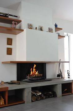 Open fireplace with concrete bench in Mérignac – – Fariello fireplaces Source by LisetteBoucaud Metal Fireplace, Open Fireplace, Marble Fireplaces, Fireplace Remodel, Living Room With Fireplace, Fireplace Design, Fireplace Mantels, Living Room Decor, Living Spaces